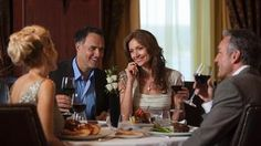 Two couples enjoying dinner - Avoya Travel Article: 'Discover Regent Cruises – All-Inclusive Luxury'