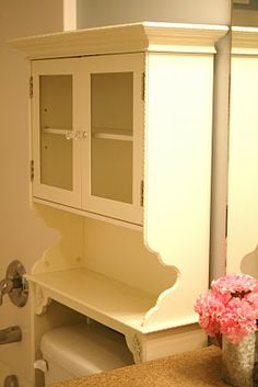 I need one of these... nice way to may it cute! bathroom cabinet makeover