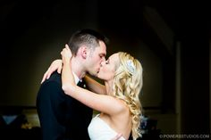 A kiss on the dance floor at The Foundry at Oswego Pointe - Powers Photography Studios