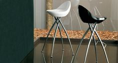 The funky Frascati bar stool has a gorgeous chrome finished metal frame. The frame legs are a cross design fixed to opposite sides of the seat, and the stool also has a simple small fixed foot rest attached to the frame. The modern seat on the Frascati is a 'tractor seat' style and is produced in a wide variety of polypropylene coloured finishes.  £178.00