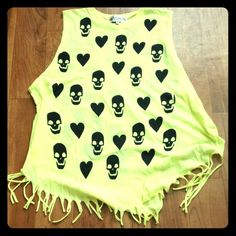 Wildfox Neon Yellow Skull Tank New without tag Wildfox tank with skulls and hearts in bright neon yellow color! Super cute with fringe details.  Note: there is a minor defect if you look at 3rd and 4th pic!! The fabric on one side of the back of the shirt is cut off. It was manufacturer's defect. But you can't really notice when you have the shirt on. It covers everything and blends in with the fringes. Wildfox Tops Tank Tops