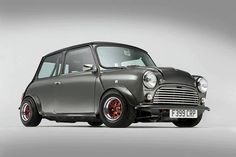 Mini Cooper - One of my favorite things! We had a black one when we lived in Germany. Mini Cooper Classic, Classic Mini, Classic Cars, Old Mini Cooper, Mini Cooper Clubman, Mini Morris, Retro Cars, Vintage Cars, Bmw