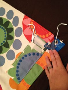 Sew fabric onto a Tarp and use as a Beach Blanket; add a pocket for tent pegs to hold blanket down with grommets that are already in place,
