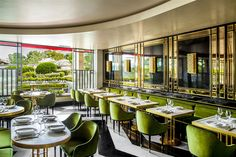 Black and white marble, green velvet chairs and LOTS of shiny brass at the new Song Qi restaurant in Monaco /// More on Interiorator.com