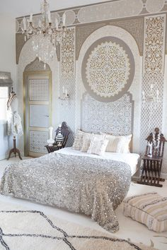Filigree wall prints, sparkly bedding and gold and white color scheme | Luxury bedroom home interior decor idea