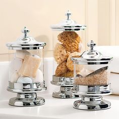 Decorative glass containers turn storage into decor. Display soap, sponges, and bath salts in pretty canisters.