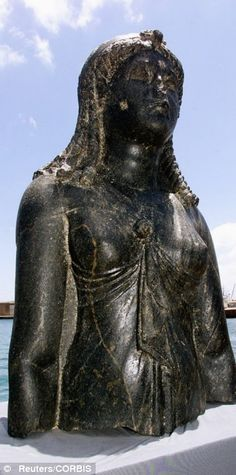 A statue of the Egyptian goddess, Isis, found in the sunken city of Heraklion. The city sank under the Mediterranean sea over 1200 years ago.  Believed to be a legend until it was discovered by accident in 2001, the city of Heraklion, home of the temple where Cleopatra was inaugurated, was one of the most important trade centres in the Mediterranean area before it disappeared into what is now the Bay of Aboukir.