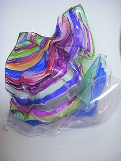 Chihuly 'Glass' bowls/forms - use colored permanent Sharpies to add lots of color, line, and pattern on clear Graphix Shrink sheets or solo clear punch cups before heating them for just seconds in a toaster oven set on Broil.