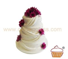 A Quiltted Egg Free Cake With Flowers The Middle Tier Being Taller Than Rest