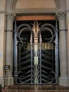 Forged steel and brass gate by Albert Paley