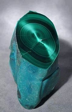 Malachite with Chrysocolla Stalactite Crystal . A vivid turquoise blue Chrysocolla exterior has been partially polished to reveal an amazing interior of velvety concentric bands of darker and lighter green chatoyant Malachite. Minerals And Gemstones, Rocks And Minerals, Rock Collection, Beautiful Rocks, Mineral Stone, Rocks And Gems, Stones And Crystals, Gem Stones, Natural Crystals