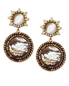 """Doris Earrings from Nicole Romano. Reminiscent of the sun and sea, these charming earrings provide an illuminating radiance. Ear posts are adorned with sun shaped arrangements of vintage givre stones and sparkling Swarovski crystals. Mother of pearl medallions set in Russian gold plating elegantly dangle for sophisticated movement.    2.5"""" earring length 1"""" diameter of top medallion 1.5"""" diamter of bottom medallion.  Handcrafted & USA Made™"""