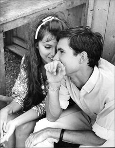 Vintage photo of Anthony Perkins sitting with a woman. -
