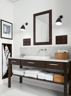 Modern bathroom with espresso vanity with white carrara marble countertop and backsplash, polished nickel wall-mounted faucet, brown inset medicine cabinet and built-in towel rack. Bad Inspiration, Bathroom Inspiration, Bathroom Ideas, White Vanity Bathroom, Master Bathroom, Bathroom Lamps, Very Small Bathroom, Lampe Gras, Modern Farmhouse Bathroom