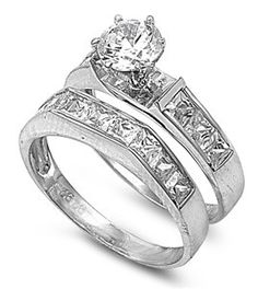 Millicent's 2CT Brilliant Cut Channel Set Band CZ Wedding Ring Set this is almost my ring mine will have nothing on the sides