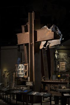 """An interior gallery displays the """"Cross at Ground Zero.""""  A steel T-beam salvaged from the wreckage of the towers, it became a rallying point for rescue and recovery workers at the site."""