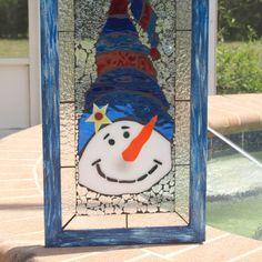 Frosty the snowman was alive as he could be  And the children say he could laugh and play just the same as you and me...    This is a limited edition, framed stained glass mosaic series we are working on here in The Salvage Studio. Please meet High Hat Snowman. He is lovingly created with a background of shattered diamond like glass and clear textured stained glass. It resembles snow and frost on the window. He is approximately 12 x 22 inches. He is framed in a hand-painted blues and white…