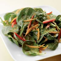 Spinach Salad with Japanese Ginger Dressing  This spinach salad tossed with spunky ginger dressing was inspired by the iceberg salads served at Japanese steakhouses across the U.S. Add shrimp for lunch or a light supper.