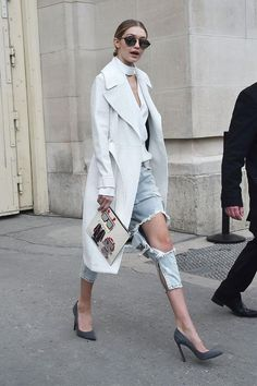 Gigi Hadid's street style during Paris couture week. Hadid paired her One Teaspoon ripped jeans with a white cut out top, A.L.C. coat, Karl Lagerfeld clutch and Illesteva sunglasses.