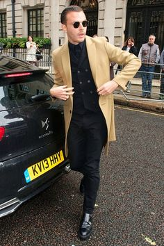 Most Stylish Men Of The Week 25.10.13 --- Theo Hutchcraft.  One of the most effective ways to wear your camel coat? Throw it over an all-black outfit, just like the Hurts' frontman – plus he gets bonus points for the double monks.