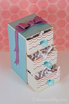 Design team member @Tiffany Johnson shared a tutorial on our blog (http://sizzixblog.blogspot.com/2012/08/3-tiered-keepsake-box-tutorial.html) sharing how to make a set of stacked drawers from @Eileen Hull's Candy Drawer die.  What kind of things can you think of to place inside a set of drawers like this one?