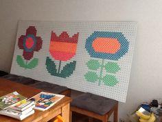 Giant cross stitch pattern on a peg board. Pattern by Alice Apple.
