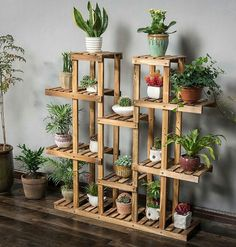 Spring is in the air and it's time to start spreading the joy throughout your home. These plant stands will hold the product of your green thumb quite nicely Wooden Plant Stands, Diy Plant Stand, Indoor Plant Stands, House Plants Decor, Plant Decor, Indoor Garden, Indoor Plants, Indoor Outdoor, Balcony Garden
