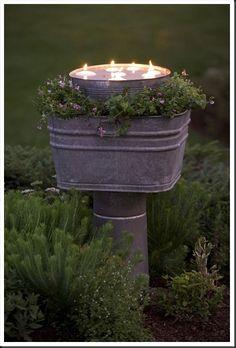 Instead of simply catching fireflies, capture the sun.  Solar Powered Ball Mason Jar Outdoor Path Light