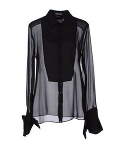 TOM FORD - Shirts. No way I'm paying that much for a shirt. But maybe I can find one similar :)