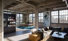 A historic building in Denver houses this modern loft, which was given a complete remodel by architect Robb Studio and interior design firm Studio Gild. The 3,000-square-foot home is an open-plan space designed for entertaining.