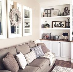 Mirrors above couch with wreath. Open the room up with mirrors.