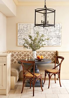 Relaxing the color scheme in a banquette signals a break from the formality of the dining room. Here, a neutral palette complements fresh greenery and modern wall art. Dining Room Banquette, Banquette Seating, Room Chairs, Table And Chairs, Plank Table, Kitchen Nook, Kitchen Dining, Kitchen Ideas, Kitchen Decor