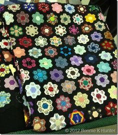 A fussy cut hexagon quilt seen on Bonnie Hunter's quiltville.blogspot.com by a student named Janice. See the detail shots, too. Really fun.