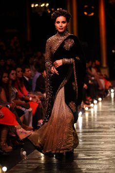 Lakme Fashion Week Sabysachi black and gold glitter sari. love the long sleeve choli that goes all the way up to the neck http://manualbookmark.net/story.php?title=pierre-wardini-youtube