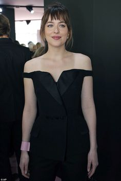Fifty Shades Of Chic! Dakota Johnson opts for timeless elegance in an off-shoulder black trouser suit as she leads the glamour at Dior PFW show