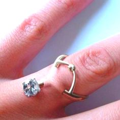 The ultimate engagement ring. Pierced into the finger?????????? OMG!