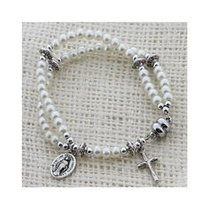First Communion bracelets are a popular gift for girls. This beautiful one will be such a lovely gift for your First Communicant!