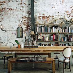Exposed brick and steel and books and big tables, oh my.