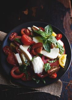 Italian Salad - Fresh Herbs, Heirloom Tomatoes, Mozzarella & a tiny drizzle of Olive Oil.
