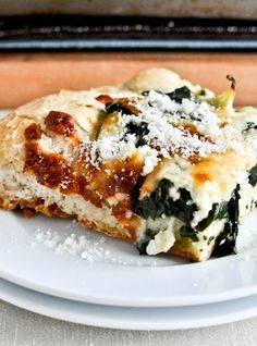 Cheesy Spinach and Artichoke Pizza - Perfect for your next cocktail hour, this creamy and delicious recipe is sure to disappear from your buffet quickly.