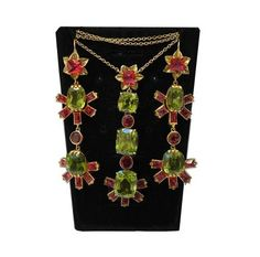Red spinel and green peridot, set in French gold. Just one of an array of fine pieces available at C & B Gems, where expert gemmologist Boris Sosna is on hand to help you select a special purchase. Christmas Gift Inspiration, Red Spinel, Green Peridot, Antique Jewellery, Natural Red, Inspirational Gifts, Luxury Gifts, Fine Jewelry, Christmas Gifts