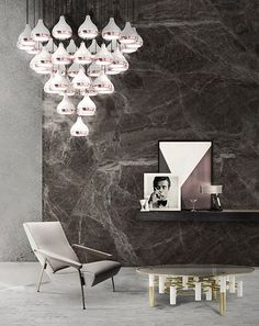 Hanna is a vintage suspension lamp that fits perfectly a living room or a hall. Its structure made in marble fits every classy and balanced ambiance, back to art deco