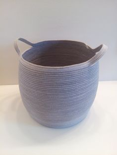 I dyed white cotton rope a soft gray color, then stitched it into shape with white and coordinating gray thread to make this unique basket.