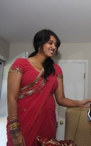 Indian Housewife in Red Saree her Boobs are Ready to Pop Out