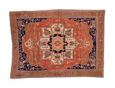HERIZ CARPET  NORTHWEST PERSIA, LATE 19TH CENTURY  Approximately 12 ft. 9 in. x 9 ft. 6 in. (389 cm. x 290 cm.)