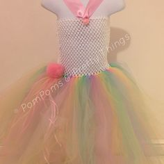 Beautiful handmade Tutu Dress in unicorn rainbow colours, featuring my signature PomPoms & gorgeous ribbons ~ made to order in your size & colour choicexxx Facebook.com/pompomsandprettythings