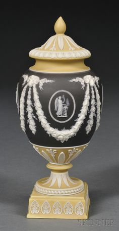 Wedgwood Three-color Jasper Dip Vase and Cover, England, 19th century, black ground center bordered with yellow, applied white relief with classical medallions between floral festoons terminating at ram's heads, foliate borders.