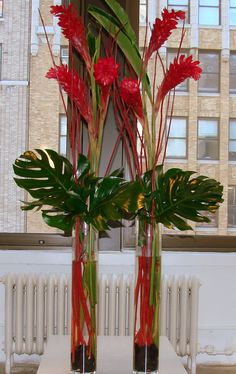 This is a selection of arrangement of red ginger with tropical green accents. See our entire selection at www.starflor.com. To purchase any of our floral selections, as gifts or décor, please call us at 800.520.8999 or visit our e-commerce portal at www.Starbrightnyc.com. This composition of flowers is generally available for same day delivery in New York City (NYC). TR004