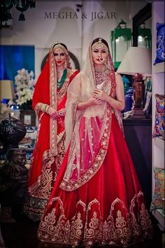 Bridal Wear - Red Velvet Bridal Lehenga | WedMeGood | Red and Gold Wedding Lehenga with Beige Net Dupatta and High Neck White Blouse Outfit by: Megha and Jigar #wedmegood #indianbride #indianwedding #lehenga #bridal #bridalwear #velvet #gold #beige