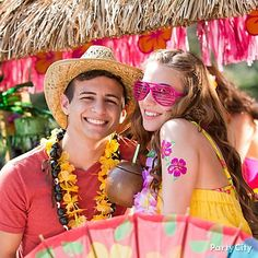 Is it tiki time yet?! A tiki bar does double-duty as a perfect backdrop for photo booth–style party pix.